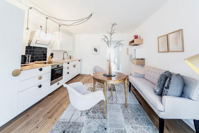 диван в интерьере кухни в скандинавском стиле
