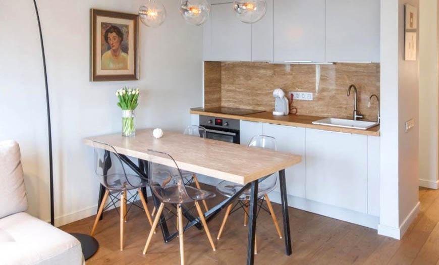 Скандинавский стиль кухни - это белый фон и простые формы.