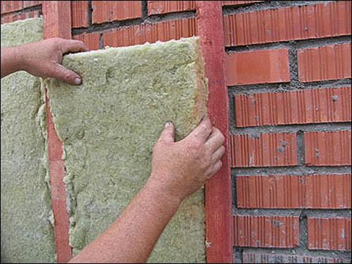 На фото - теплоизоляция стен